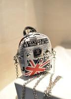 The new 2014 mini shoulder bag rivet slanting across han edition cute little cell phone bag printing bag free postage