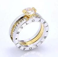 Free shipping + gift.Brand women's ring.Super fashion can move & three wear method & rhinestone & 18 KGP Yellow gold ring.