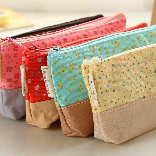 http://i00.i.aliimg.com/wsphoto/v0/1914466148_2/Cute-Fabric-Cotton-Flower-Pencil-Case-Kawaii-Cartoon-Pink-Trojan-Pencil-Bag-Stationery-for-School-Girl.jpg