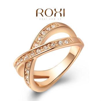 Roxi женское кольцо, ручная работа, изготовлено из розового золота с трех разовым золотым напылением, граненая изогнутая спираль украшенная яркими австрийскими кристаллами, безупречный дизайн
