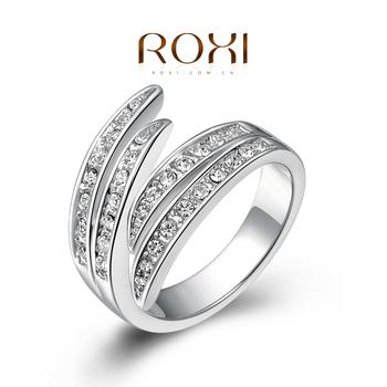 Roxi женское кольцо ручной работы, выполнено из белого золота с трех разовым золотым напылением (позолота), украшенное сверкающими австрийскими кристаллами, необычный дизайн, высокое качество