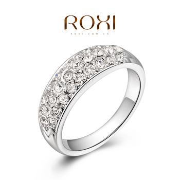 Roxi элегантное брендовое женское кольцо ручной работы, выполнено из белого золота с трех разовым золотым напылением, украшенное в три ряда сверкающими австрийскими кристаллами