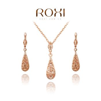 Roxi элегантный женский комплект украшений:серьги и ожерелье,ручная работа, изготовлен из розового золота с трех разовым золотым напылением,серьги и подвеска выполненые резными сферами, длина серьг 4.5см,подвеска 3.9см