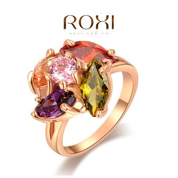 """Roxi яркое, оригинальное женское кольцо""""Летний сад"""", выполнено из розового золота с трех разовым золотым напылением и украшено насыщенными, гармоничными сочитаниями разных оттенков камней из швейцарского циркония"""