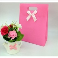 50 PCS pure color pink bowknot clamshell jewelry bag paper gift bags with handles 16.5 * 12.5 * 6 cm