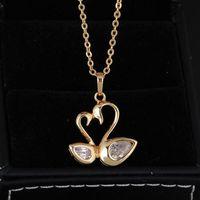 Women Gold Plated Swans Peach Heart Shape Crystal Zircon 27*20mm  63212