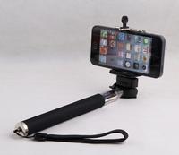 Phones remotely control Bluetooth remote camera control self-timer shutter + phone + camera tripod clip free shipping