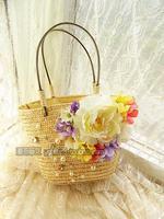 The new Korean version of the female flower handbag fashion straw bag beach resort