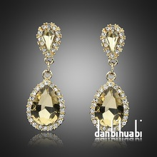 Fashionable High quality emerald crystal Earring champagne rhinestone earrings sell at a low price for women jewelry