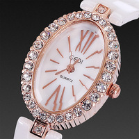 Top brand free shipping 2014 casual quartz analog oval design with crystal diamonds roman number rose gold ceramic watches women