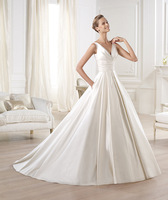 Princess-style wedding dress in satin Bodice with V-neck gathered at the bust with a draped sash to the waist  wedding dress