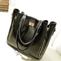 Metal cross buckle cowhide female bags portable women's cross-body handbag rivet shoulder bag cowhide female