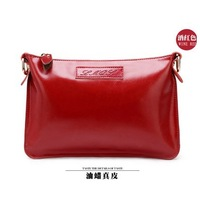 Free shipping! Fashionable shoulder slope across cow leather bags.
