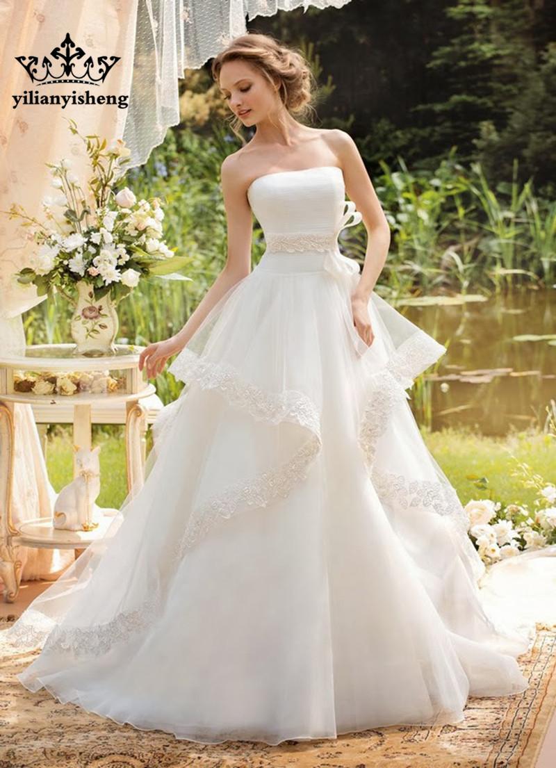Boob tube supérieur un- ligne de sol- longueur du train tribunal arc, hors de l'épaule manches en dentelle robes de mariage mariée new2014