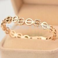 14k rose gold plsted  titanium steel ri bangles