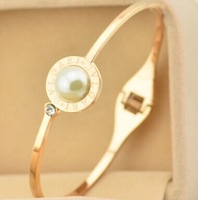 14k rose gold plsted  titanium steel B+pearl bangles