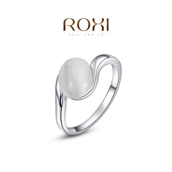 Roxi женское кольцо, 100% ручная работа, изготовлено из розового золота с трех разовым золотым напылением, выгровировка в виде камня посредине, украшенная опалом