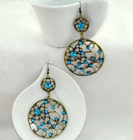 Carve patterns or designs on woodwork personality are round crystal tassel hanging long earrings earrings a couple