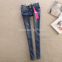 The European station! 2014 Hitz blue leather fight double button show thin leg pants /pencil Jeans Women