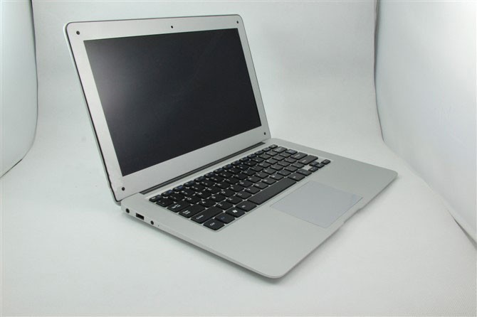 Wholesale 14 inch super thin laptop Intel D2500 1.86 Ghz Dual Core 14'' windows ultra notebook Win 7 OS(China (Mainland))