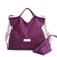 Counters authentic European and American fashion leather handbags nylon fabric with two-piece casual handbags buy Gains two free