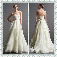 Saucy Full Tiered A-line Floor length Chapel train Sweetheart Neckline Organza Wedding Dress With Ribbon
