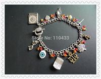 Divergent inspired charm bracelet hand Amity tree Erudite eye Candor scale apple glasses budding heart BF172