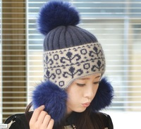 The new autumn and winter fashion lady real leather hat hair bulb  Angora wool cap  Warm ear warmers knitted headgear