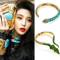 Anna dello russo blue rhinestone snake necklace