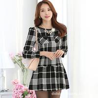 2014 new Autumn and Winter Korean small slim long sleeved elegant black and white plaid o-neck pocket woolen Dress