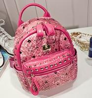 Free shipping Fashion snake snakeskin shoulder bag full rivet punk shoulders backpack schoolbag small and medium number