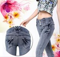 2014 hot feet pants bowknot of tall waist fall Skinny jeans Ladies fashion jeans