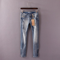 2014Women's handsome slim elastic distrressed trousers zipper water wash denim trousers pencil pants
