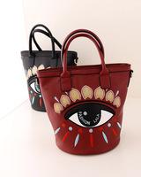 Big eyes embroidery handbag