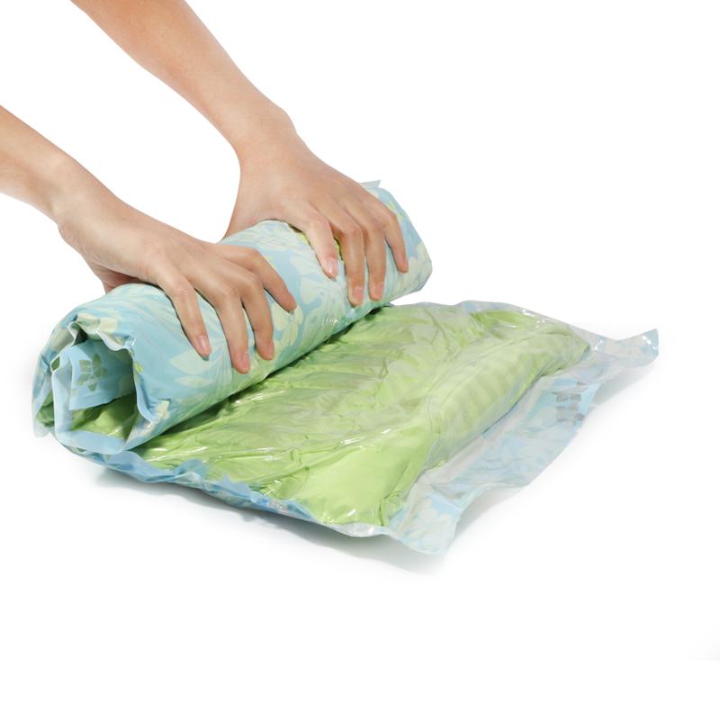 One set 6 pcs travel clothing hand roll plastic storage bag space saving vacuum compressed bags(China (Mainland))