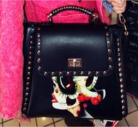 Wholesale supply 2014 new fall fashion rivet handbag shoulder bag painted European and American fashion handbags Messenger