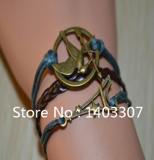 6Pcs Hot Sale Cute Hunger Game Bird Eiffel Tower With Star Shaped Braid Leather Bracelets Bangles Vintage Bracelets Women Girls(China (Mainland))