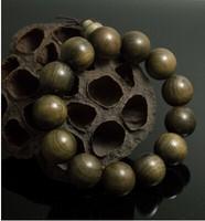 The best dark wood of gold rimmed nanmu Phoebe hand on hand on dark ebony cat eye beads bracelet for men and women section