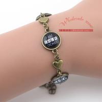 30pcs/lot I Am Sherlocked Glass Cabochon charms bracelet,Sherlock Holmes vintage bracelet