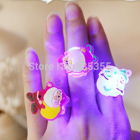 12PCS Christmas Flash Light Santa Claus Ring Kid Toy Party Favor Supply Bag Prop Gift(China (Mainland))