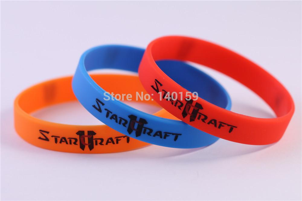 Wholesale 12pcs StarCraft 2 Silicone Wristbands StarCraft 2 Protoss Terran Zerg Game Around Gift(China (Mainland))