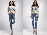 New design hot sale autumn winter loose hole capris 2014 women's jeans pants large sizes women's jeans pants