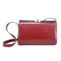 Clip elegant women's dinner handbag fashion one shoulder cross-body iron wallets cowhide Wine red
