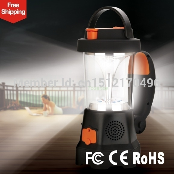 Emergency led Beautiful Mini camping lantern SOS Function Wind Crank Charge Fm portable radio Emergency mobile phone(China (Mainland))
