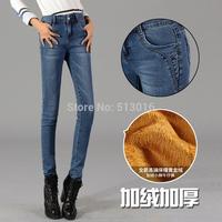Free shipping 2014 winter Korean version plus thick velvet jeans female pencil jeans warm Slim pencil jeans ball