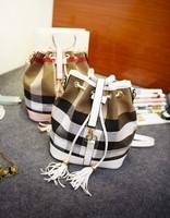 Hot sales Top rucksack grid  bag female new cylinder draw string backpack fashion one shoulder aslant tassel bag ladies bag