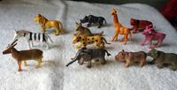 12pcs animals elephant lion giraffe rhinoceros deer wolf beer plastic toy model