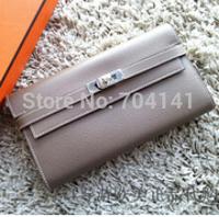 23*12*3CM NEW ARRIVAL . Unique Design & Elegant Classic Brand Long purse Genuine Leather Wallet . Free Shipping