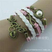 2015 Hot sale Europ fashion jewelry Hand-woven lock heart LOVE pearl leather cord bracelet Z353 hearts a figure 8 pulseras