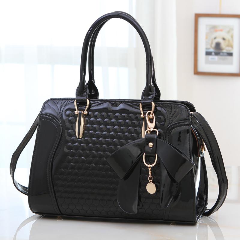 http://i00.i.aliimg.com/wsphoto/v0/32269730118/Mujeres-de-moda-de-bolso-bolsos-de-moda-bolsos-femeninos-de-charol-bolso-del-mensajero.jpg